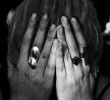 girl with dreadlocks (head in hands). by geof