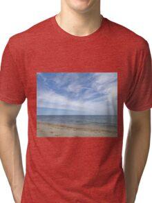 Sandy ocean beach under pretty blue sky Tri-blend T-Shirt
