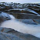 Stone outcrop at the White Falls, Iceland by Dave McBride
