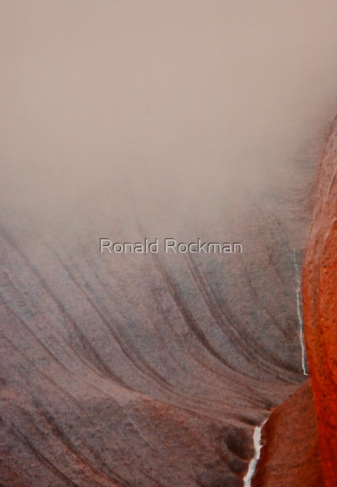 Mist and Cloud Rolling Down On Uluru by Ronald Rockman