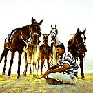 Shepherd sitting with his horses by Chaim  Schvarcz
