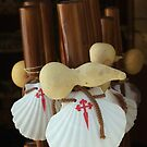 Scallop shell and gourd walking sticks by Richard McCaig