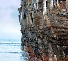 icicles dripping on a cliff face by morrbyte
