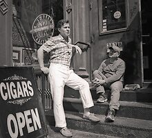 New York City: two men and store front by Ron Greer