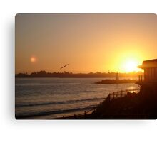 Sunset by the lighthouse Canvas Print