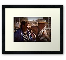 Watching the action Framed Print