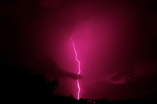 Lightning across a night sky by Keith Larby