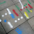 Pavement graffiti by Holly Burns