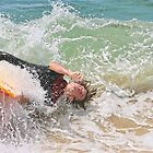 Taking a nap on the shore break by Murray Swift