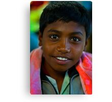 the boy in the market Canvas Print
