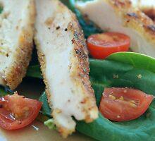 Chicken strips over salad by Leon Heyns