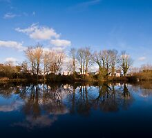 Cosgrove Park across a fishing lake by David Isaacson