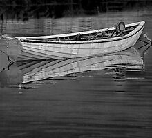 Moored boat in Peggy's Cove. by Randall Nyhof