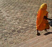 Late for work-Labourer in saffron Sari, India by mypic