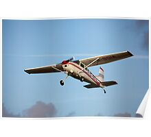 A Cessna 180K in flight Poster