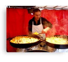 Potatoes cook Canvas Print