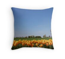 Single tree by the field of tulips Throw Pillow