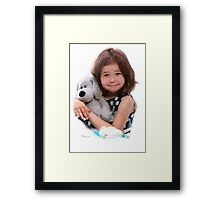 Child with doll Framed Print