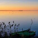 Moored fishing boats at sunset, Lago Trasimeno, Umbria, Italy by Andrew Jones