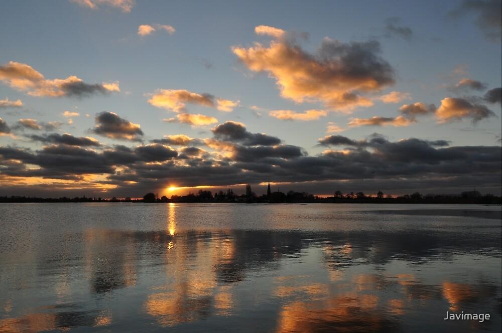 Sunset over Langeraar reflecting in the lake by Javimage
