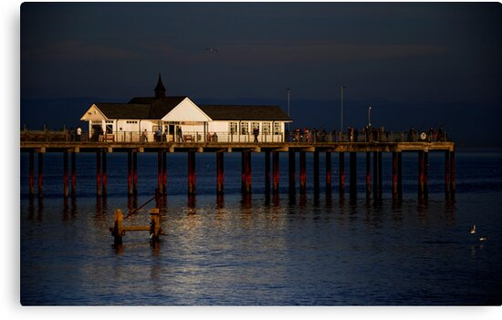 Southwold Pier in evening light. by Karen  Betts