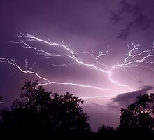 Lightning reaching up to the sky by Laura Davis