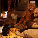 Potato Seller & Cat by Vikram Franklin