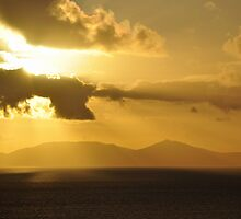 Sunset over South Uist from Neist Point by Rupert Connor