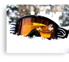 Goggles in the Snow Canvas Print