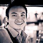 Tuk Tuk driver. by Keegan Wong