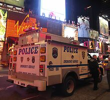 NYPD Vehicle on Broadway at Night - Manhattan by Bev Pascoe