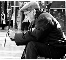 A moment to catch up with the news.. Photographic Print