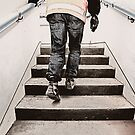 Worker on stairs by Trish  Anderson