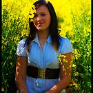 Teen in field of gold by thermosoflask