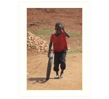Child playing in Uganda Art Print
