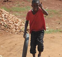 Child playing in Uganda by Marion Joncheres