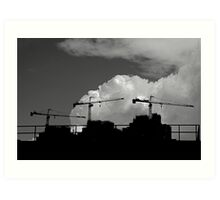 Triple cranes against the sky Art Print
