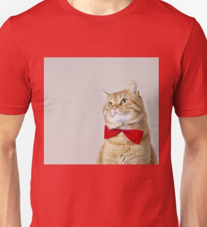 Red Cat sitting and looking up with a red ribbon,bow isolated on grey background. Unisex T-Shirt