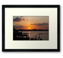 Sunset beyond the dock on the bay Framed Print