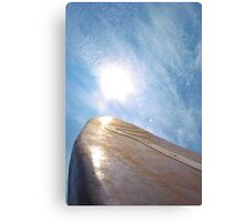 Surfing to the sky Canvas Print