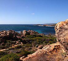 Rocky shores on a blue ocean by georgieboy98