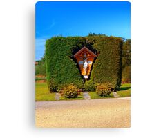 Jesus, a cross and a trimmed bush Canvas Print