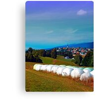 Hay bales, clouds and some scenery Canvas Print