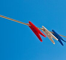 Perfect Day - Pegs on a clothesline on bluesky by artypantsart