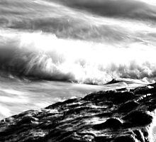 Waves on rocks by jimclark