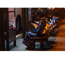 Japanese girls in yukata glued to smartphones Photographic Print