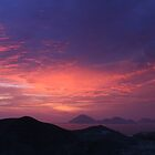 Fire in sky over coastal islands by jorginho