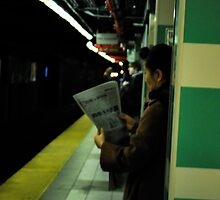 reading the paper,  by Jeff Stroud