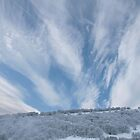 Jet stream clouds on an icy day by Jane Corey