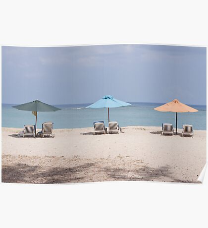 reclining chairs and beach umbrellas. Poster